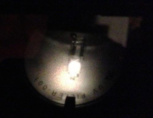 Halogen desklamp through a pinhole